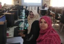 Non teaching staff receiving IT training